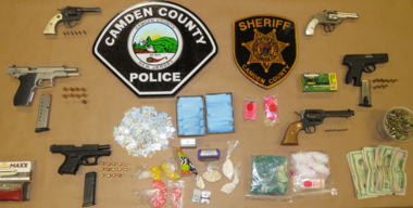 """In this photo provided by Camden County authorities, illegal weapons, drugs and drug paraphernalia are pictured following a raid on an alleged """"drug mill"""" on Nov. 9, 2016."""