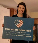 Robin Coyne poses with an anti-hate speech sign. (Courtesy of Hate Has No Home Here Camden County/South Jersey)