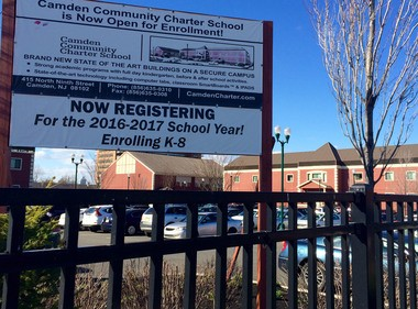 A sign encouraging enrollment for the Camden Community Charter School is displayed outside of the campus, March 2, 2017. The state Department of Education did not renew the charter's application in the wake of dismal test scores. (Greg Adomaitis | For NJ.com)