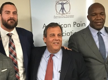 Former NFL players Todd Herremans, left, Marvin Washington, far right, with Gov. Chris Christie (R-NJ), at opioid-pain medication summit in Camden on Wednesday.