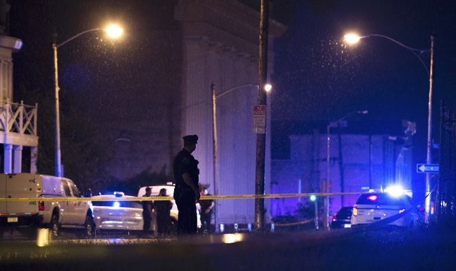 Police secure Broadway and Spruce Street in Camden Tuesday evening, Aug. 7, 2018. (Joe Lamberti |Camden Courier-Post via AP)