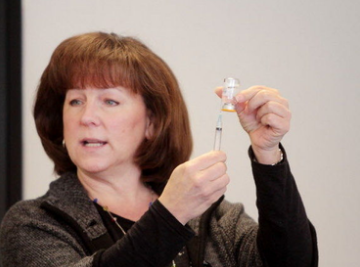 Babette Richter of the South Jersey AIDS Alliance demonstrates how to administer naloxone (Narcan) in case of a heroine overdose, during a training and certification class at the Swedesboro Library, Saturday, March 15, 2014. (Staff Photo by Calista Condo/South Jersey Times)