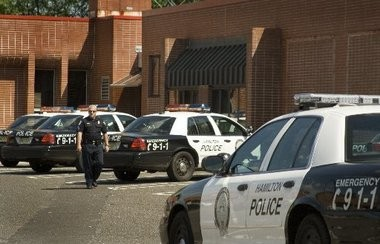 FILE PHOTO: A Hamilton police officer walks to his car from the Police Station located on Whitehorse Mercerville Road.