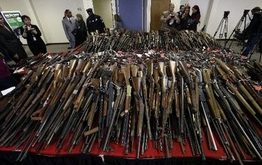 Guns are displayed on tables in Camden, N.J., Tuesday, Dec. 18, 2012, after New Jersey Attorney General Jeffrey Chiesa announced that last weekend's gun buyback event brought in more than 1,100 guns. He says it appears that the mass killing at a school in Newtown, Conn., may have motivated some to turn in their weapons for up to $250 each. Trenton will hold its own gun buyback on Friday and Saturday.