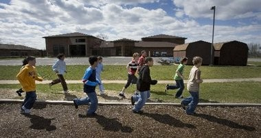 A file photo of children outside of an elementary school.