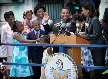Tony Mack, right hand raised, is sworn-in as mayor of Trenton, New Jersey during his inauguration ceremony on the steps of city hall Thursday afternoon, July 1. 2010.