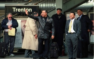 Then-Trenton Mayor Douglas Palmer, waving at center, and then-Mercer County Freeholder Tony Mack, standing second from right, stand on platform at the Trenton Train Station in February 2001 awaiting the annual NJ Chamber of Commerce train.