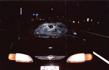 The windshield of the black Ford Mustang was smashed in the crash.