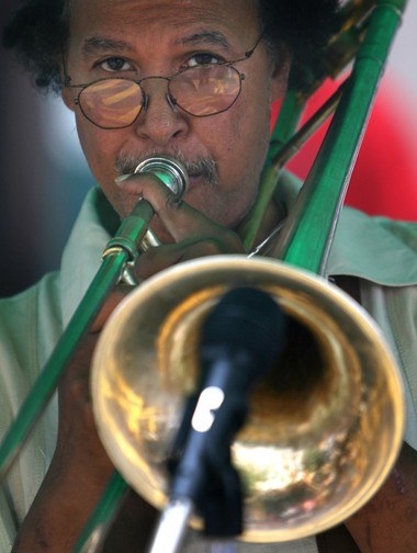 Trenton-born and world-renowned trombonist Clifford Adams performs at the opening day of Capital City Market, downtown on E. State Street. (Michael Mancuso/The Times)