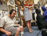 James Sikora of Ewing, left, listens to, and records, Lea Petri, founder of the non-profit Classical Music for All in Lawrenceville, as she plays violin on September 11, 2015. (Keith A. Muccilli/ For The Times of Trenton)