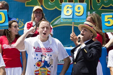 Joey Chestnut, shown here during the 2013 Nathan's Famous Fourth of July International Hot Dog Eating contest, will be in Trenton on Saturday for a pork roll eating contest.