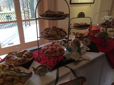 An Alice doll sits next to a cookie platter decorated for the Mad Hatter tea party at the Trenton City Museum Sunday Nov. 29, 2015.
