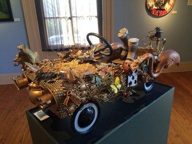 """A car collage by Valerie Young displayed in the Trenton City Museum's """"Alice Revisited"""" exhibit."""