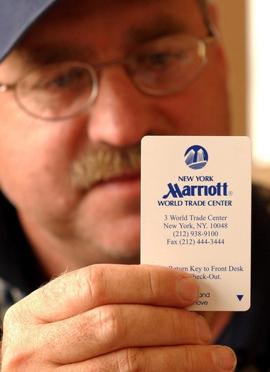 Roger Eisenbarth holds the card key to his room at Marriott Hotel at the World Trade Center shortly after returning to his home in Colorado in 2001. (Denver Post photo by Hyoung Chang)