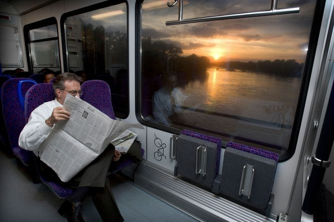 A commuter takes the River Line home from work. (Michael Mancuso | For NJ.com)