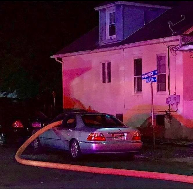 A car parked in front of a fire hydrant Thursday morning as firefighters battled a small blaze. (Hamilton Township Professional Firefighters)