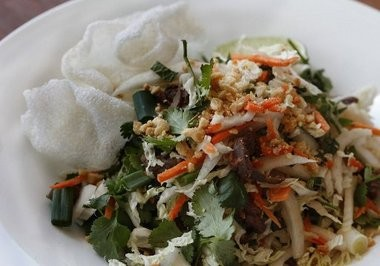 A shredded cabbage, carrot, mint cilantro, peanut salad with beef and a soy vinaigrette reflect the flavors of Vietnam.