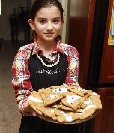 Maya Blackin shows off a platter of s'mores hamantaschen.