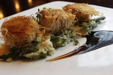 Pan seared phyllo spun scallops served with asparagus risotto and fig infused balsamic reduction.