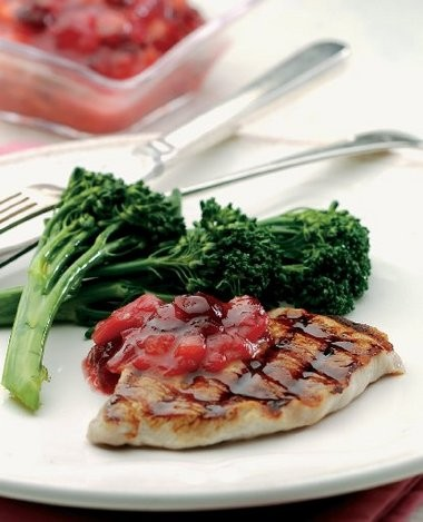 Grilled pork chops with rhubarb chutney, a low-fat dish whose savory-tart-sweet combination takes the classic pairing of pork and fruit to a new level. It uses boneless pork chops because they're quick to cook.