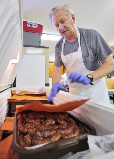 Dave Angalet of Somerset checks on a tub of kolbasz pork sausage in a freezer at the Magyar Reformed Church which will be served for their 39th Hungarian Festival on June 7th. The sausage is made at the church for the event.