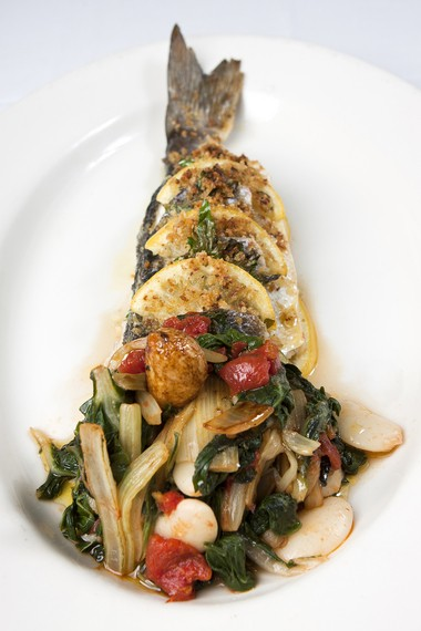 Branzino Al Forno --- an entree of oven-roasted Mediterranean sea bass, with virgin olive oil, fresh lemon, Italian parsley and sea salt, served with sauteed Swiss chard and spagna beans at Undici Taverna Rustica in Rumson.