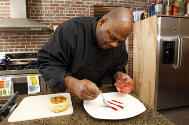 Chef Jesse Jones of West Orange makes banana cake with banana glaze with almonds with raspberry reduction.
