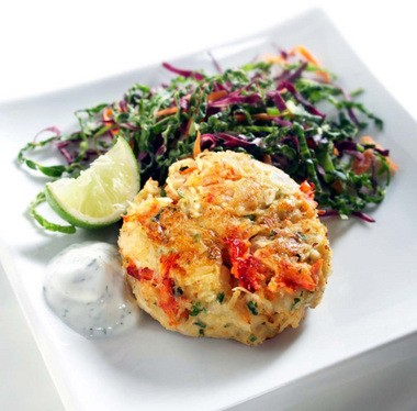 Crab Cakes With Coleslaw and Lime-Dill Yogurt Sauce. This summery recipe for low-fat crab cakes lavished with a light and savory coleslaw and yogurt sauce is perfect for cooks reluctant to spend time in a steamy kitchen.