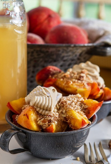 Raw peach cobbler with coconut cashew cream topping prepared by award-winning chef Dorothy Salvatori.