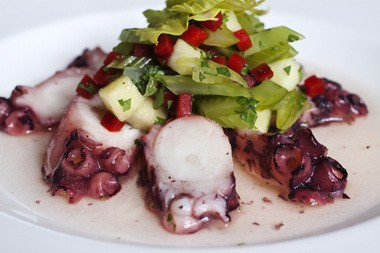 Marinated Portuguese octopus, pineapple & red pepper with celery leaves and spiced vinaigrette.