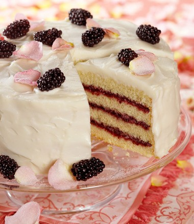 A Lemon Ginger Cake With Blackberry Curd Filling. This is a cake whose fresh lightness lifts the taste of spring into summer, blending lemon and ginger with a berry sweet filling. It would be a charming addition to a tea-time table, an eyecatching dessert for a special dinner.