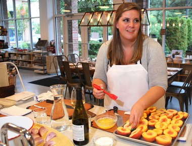 Gabriella Siboni prepares grilled peaches during a grill-themed cooking class at Heirloom Kitchen in Old Bridge.