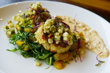 Crab Cakes, with acorn squash, sorrel salad, corn and avocado salsa, and a chipotle remoulade, served at District Riverton Bistro in Riverton, NJ.