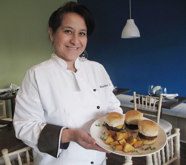 Chef Marita Lynn from Peruvian restaurant, Runa in Red Bank holds a plate of her signature Runa burgers made with quinoa.