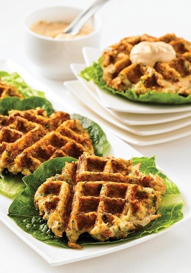 Crispy crab cakes with chipotle aioli. The crab cakes can be mixed, formed into patties, and frozen up to three months before cooking on your waffle maker. (Matt Johannsson, Reflector Inc.)