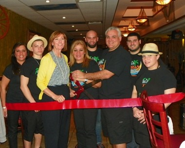 Lidia's Cuban Kitchen, 117 North Union Ave. recently celebrated its grand opening. Pictured from center is Downtown Director Kathleen Prunty with owners Lidia Galvez, Joe Dellefave with family and friends.