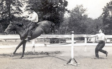 Pictured is Gil Neville on horseback with Eugene Coppola in the ring.
