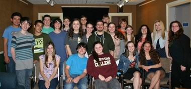 Some of the cast of 'Urinetown, The Musical' with Musical Director Jack Bender (center).