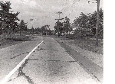 Boulevard looking west, 1940s, before construction of Parkway overpass. Entrance to Galloping Hill Golf Course on right. Beth David Cemetery maintenance building partially visible under American flag. (Photo courtesy Walter Boright)