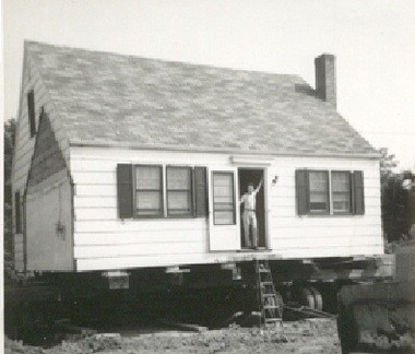 Frank and Grace Garrick home, 1950, with son Frank in doorway, ready to be moved from Fairfield Ave to 451 Colfax Ave. (Photo courtesy of son, Frank Garrick)