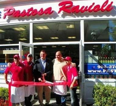 Pictured at the ribbon cutting ceremony for Pastosa Ravioli are Cranford Mayor Andis Kalnins and owners Vinny Vallely, Anthony Ajello and Bill Vallely. (courtesy photo)