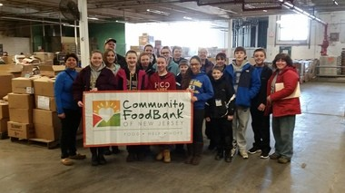 Girl Scouts of Cranford and Confirmation candidates from St. Michael Church joined together to volunteer at the Community FoodBank of New Jersey in January. They sorted and packed boxes of food that will be distributed to more than 900,000 people in NJ. (courtesy photo)