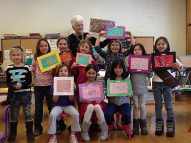 Pictured are Brownie Troop 40035 with Patricia Novy and their Jackson Pollack paintings showing a happy, calm or angry feeling using line and color. courtesy photo)