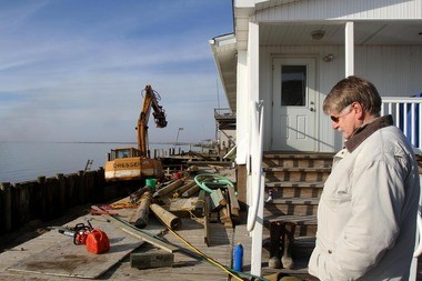 Jim Fonash looking at bulkhead being replaced after Sandy caused $250,000 in damages to his Charlesworth Hotel in Fortescue.