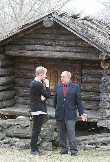 In this September 2011 file photo, Alfred Nicolosi, right, speaks with a visiting Swedish high school student at the farmstead.