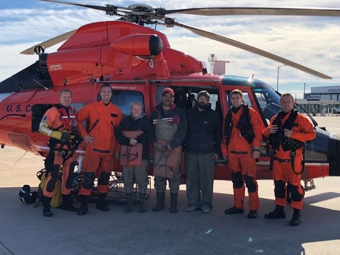 The Coast Guard hoisted three stranded boaters to a helicopter on Wednesday after their skiff ran aground in the Delaware Bay. (Coast Guard photo)