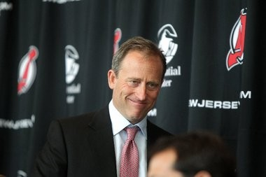 Josh Harris attends a press conference in August at the Prudential Center in Newark announcing that an investment group led by himself and David Blitzer has taken an ownership stake in the team.