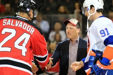 """Josh Harris shakes hands with Devils captain Bryce Salvador, left, and Islanders captain John Tavares before the Devils home opener in October. Harris described the shootout loss as """"a great night"""" that """"could have been better."""""""