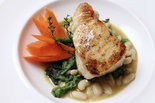 Chilean sea bass with cannellini beans and broccoli rabe