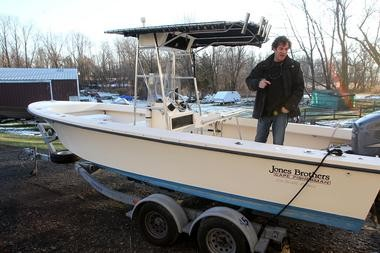 Mickey Melchiondo, formerly of the band Ween, checks out his boat, parked in a boatyard in New Hope, Pa., where he lives.